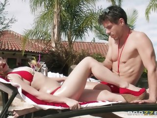 Sun lover Dani Jensen gets..